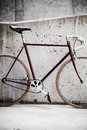 City bicycle and concrete wall, vintage style Royalty Free Stock Images