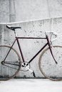 City bicycle and concrete wall, vintage style Stock Images