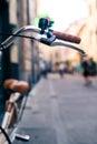 City bicycle handlebar, bike over blurred beautiful bokeh backgr Royalty Free Stock Photo