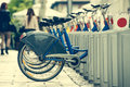 City bike hire row of bicycles for on a street Royalty Free Stock Photos