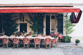 City cafe with wicker chairs on the sidewalk, small restaurant Royalty Free Stock Photo