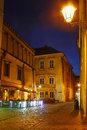 City center by night: ancient temements Krakow, Poland Royalty Free Stock Photo