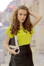 City chic girl with neon blouse
