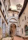 City gate in spoleto italy the ancient porta fuga the medieval town umbria Stock Photos