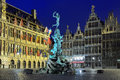 City hall brabo fountain and houses of guilds in antwerp evening view the on the great market square belgium Royalty Free Stock Photography