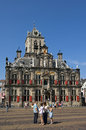 City hall and tourists delft netherlands the historic town is built by the architect hendrick de keyser in dutch renaissance style Royalty Free Stock Photos
