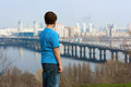 City kiev boy looks at the and the dnieper river ukraine Royalty Free Stock Photography
