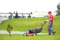 City landscaper cutting grass Royalty Free Stock Photo