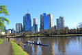 City life melbourne local athletes training rowing in yarra river on sunday morning in australia Stock Photo