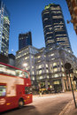 The city of london at night contemporary buildings and red bus Royalty Free Stock Images