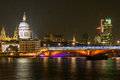 City of london skyline at night the with st paul s cathedral as seen from the south bank river thames on a dark autumn evening Royalty Free Stock Photo