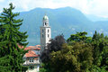City of lugano switzerland landmark church tower in with lake and surrounding swiss alps Royalty Free Stock Photos