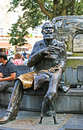 The city mayor and his dog brussels belgium june sit by me statue of charles buls famous that sits on edge of fountain with Stock Photo