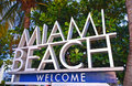 City of miami beach florida welcome sign with palm trees on a sunny summer day Royalty Free Stock Photo