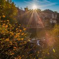City near river in on autumnal sunny day Stock Photo