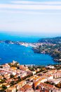 City of nice panorama france on mediterranean sea with building with red red roofs and boats in port Royalty Free Stock Photos