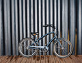 City night snapshot of a fashionable bicycle standing near a black sea container Royalty Free Stock Photo