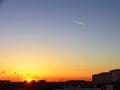 City over sunset οι νεροχύτες ή ιων πίσω από τα κτήρια Στοκ εικόνες με δικαίωμα ελεύθερης χρήσης