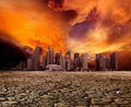 City overlooking desolate landscape Royalty Free Stock Photo