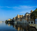 City palace udaipur india romantic luxury tourism concept background and lake pichola rajasthan Royalty Free Stock Image