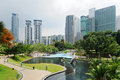 City park with modern buildings in kuala lumpur downtown of Stock Image