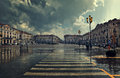 City plaza at rainy day in cuneo italy pedestrian crossing and big center under cloudy sky Royalty Free Stock Photography
