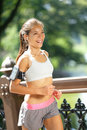 City runner jogging with music in new york city woman central park manhattan wearing earphones and armband for smart phone Royalty Free Stock Photo