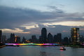 City skyline bridges over pearl river boats on river and panorama of at night Stock Image