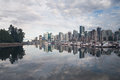 City skyline reflections in ocean bay from Stanley park Royalty Free Stock Photo