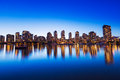 City skyline at sunset modern urban reflecting in water vancouver Royalty Free Stock Image