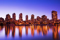 City skyline at sunset modern urban reflecting in water vancouver Royalty Free Stock Photography