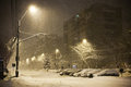 City snowfall at night with empty streets Royalty Free Stock Image