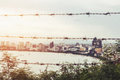 City space of Pattaya city and shore in sunrise, with blurred barbed wire foreground, abstract concepts, vintage tone Royalty Free Stock Photo