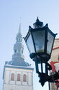 City street lantern on a background of church niguliste Royalty Free Stock Photography