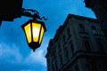 City street light yellow against the blue sky and old houses riga latvia Royalty Free Stock Photos