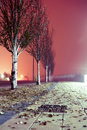 City street at night winter foggy sidewalk Royalty Free Stock Image