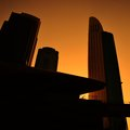 City in sunset business silhouettes of buildings against orange sky Stock Photography