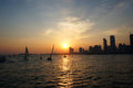 City sunset sailboat seaside at qingdao Stock Photos