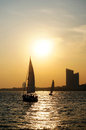 City sunset sailboat seaside at qingdao Stock Images