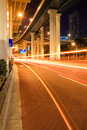City traffic under the viaduct at night Stock Photos