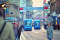 City tram blue trams in busy Royalty Free Stock Photography
