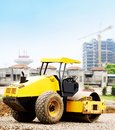City under construction a road roller at site in background Stock Photos