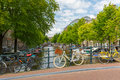 City view of Amsterdam canal, bridge and bicycles, Holland, Neth Royalty Free Stock Photo