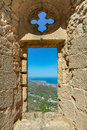 City view through the window of an ancient fortress Royalty Free Stock Photo