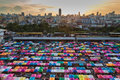 City weekend market aerial view with multi colour umbrella during sunset Royalty Free Stock Photo