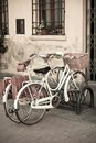 City White Bicycles with Basket Royalty Free Stock Images
