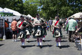 City of winchester pipes and drums performing at the delaplane strawberry festival in delaplane virginia usa may sky meadows state Royalty Free Stock Photos
