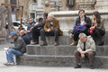 Citylife people sitting on the steps of a fountain in center catania sicily italy piazza del duomo main city square in catania Royalty Free Stock Image