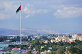 Cityscape of aqaba jordan march flag waving over the city has one the highest growth rates in with only the Stock Images