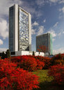 Cityscape business buildings offices autumn two rising up above red bushes on a bright sunny days in prague pankrac czech republic Stock Photo